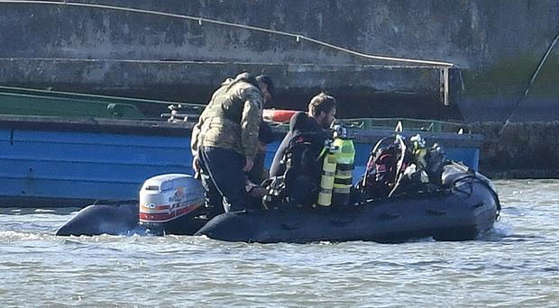 Royal Navy bomb disposal divers on a boat in King George V Dock close to London City Airport (Dominic Lipinski/PA)