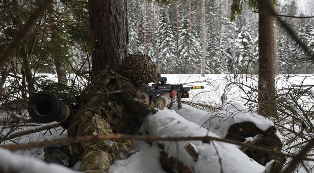 A soldier from 1st Battalion The Royal Welsh fires blank rounds during Exercise Winter Camp (Joe Giddens/PA)