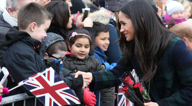 Meghan Markle meets onlookers on her walkabout outside Edinburgh Castle (Andrew Milligan/PA)