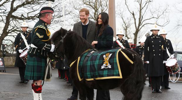 Pony Major Mark Wilkinson and regimental mascot Cruachan IV were among the welcoming party (Andrew Milligan/PA)