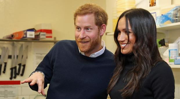 Prince Harry and Meghan Markle during a visit to Social Bite in Edinburgh, during their visit to Scotland (Owen Humphreys/PA)