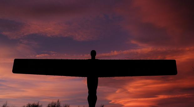 Lenticular clouds form behind the Angel of the North in Gateshead