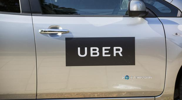Uber saw annual losses balloon by 61%, but cheered a step towards profits in the final three months (Laura Dale/PA)