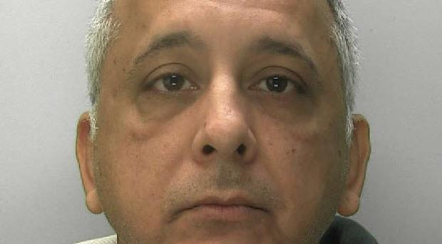 Former teacher Rahul Odedra has been jailed for filming females in school toilets (Gloucestershire Police/PA)