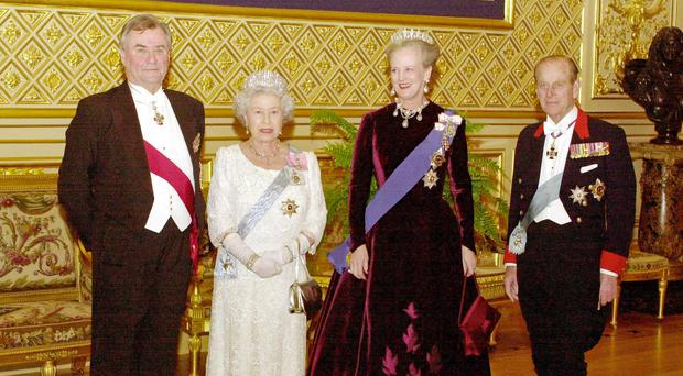 Prince Henrik of Denmark with the Queen, Queen Margrethe of Denmark and the Duke of Edinburgh (John Stillwell/PA)