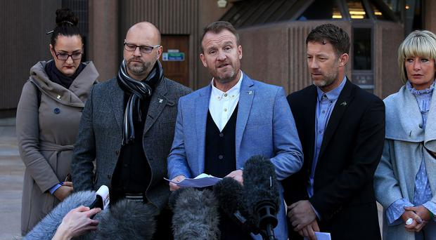 Chris Unsworth, Micky Fallon and Steve Walters (left to right) speak outside court. (Peter Byrne/PA)