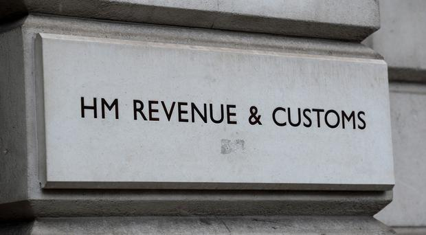 A view of signage for HM Revenue and Customs in Westminster, London (Kirsty O'Connor/PA)