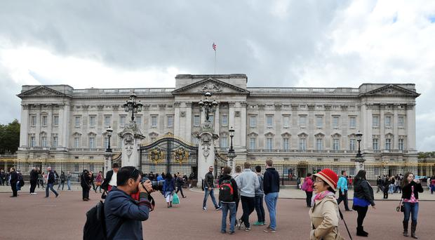 A US tourist took offence to an officer outside Buckingham Palace and assaulted him (Nick Ansell/PA)