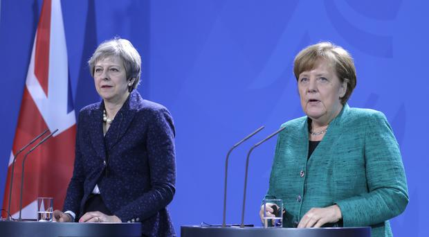 Theresa May and Angela Merkel (Markus Schreiber/AP)