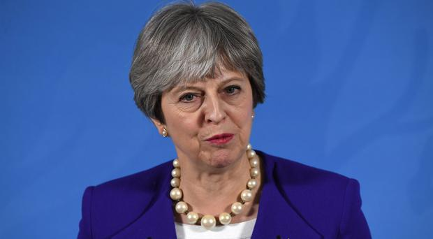 Theresa May is setting out plans for a new treaty between the UK and the EU to enshrine security cooperation after Brexit (Paul Ellis/PA)