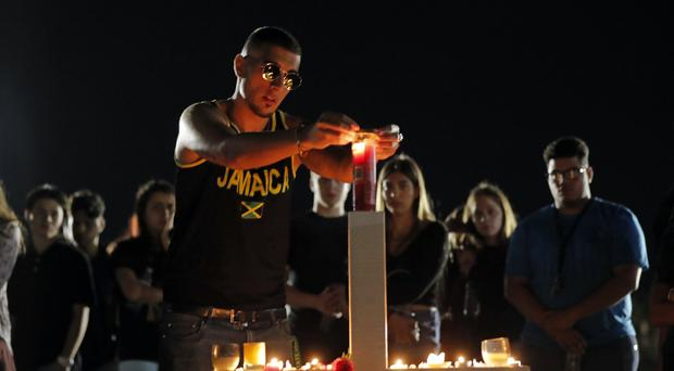 A candlelight vigil has been held for the victims of the Wednesday shooting at the school, in Parkland (Gerald Herbert/AP)