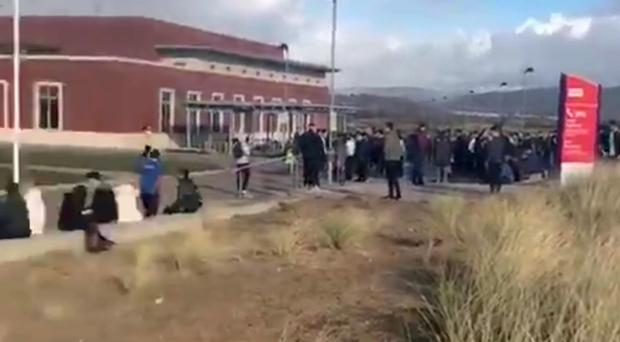 Screen grab taken from a video posted on Twitter by @SweetlyShan of Swansea University Bay Campus being evacuated (@SweetlyShan)