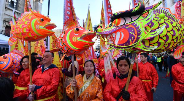 Participants take part in the Chinese New Year parade in London (John Stillwell/PA)