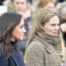 Meghan Markle, during a walkabout on the esplanade at Edinburgh Castle, standing next to her royal aide Amy Pickerill. (John Linton/PA Wire)
