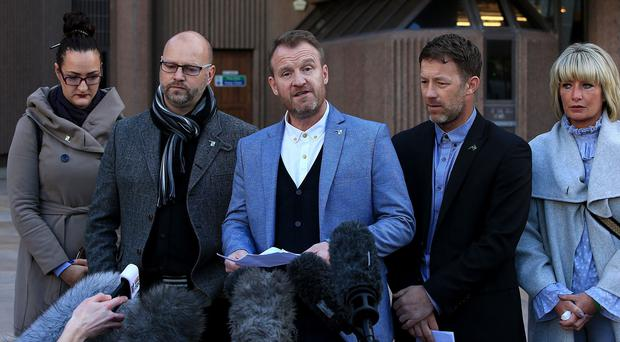 Chris Unsworth (second left), Micky Fallon (centre) and Steve Walters (second right), victims of Barry Bennell, speak to the media (Peter Byrne/PA)