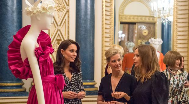The Duchess of Cambridge and the Countess of Wessex (centre) with designer Stella McCartney (right) at a reception to celebrate the Commonwealth Fashion Exchange at Buckingham Palace (Dominic Lipinski/PA)