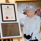 Queen Elizabeth II unveils a charter during her visit to the Royal College of Physicians in London, to mark the 500th anniversary of the body's founding Charter (Chris Jackson/PA)