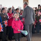 Bella Armstrong, 6, from Innsworth, looks at her mum after the Prince of Wales misses her trying to give him flowers (Ben Birchall/PA)