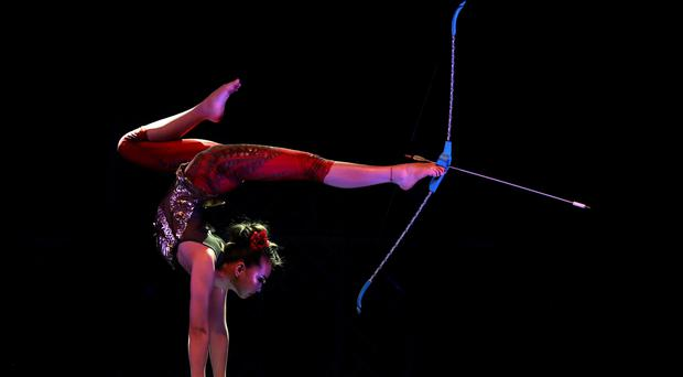 Contortionist Odka uses a bow and arrow as she performs with the Cirque Berserk at the Festival Theatre in Edinburgh to celebrate the 250th anniversary of the circus being invented (Andrew Milligan/PA)