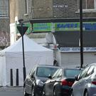 A police forensics tent on Bartholomew Road in Camden, London (Yui Mok/PA)