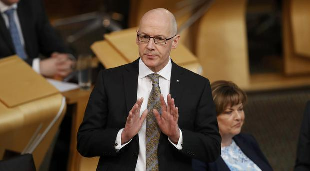 John Swinney faces questions on officials' contact with Parliamentary witnesses over Named Person legislation (Russell Cheyne/PA)