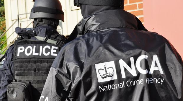 National Crime Agency officers (NCA/PA)