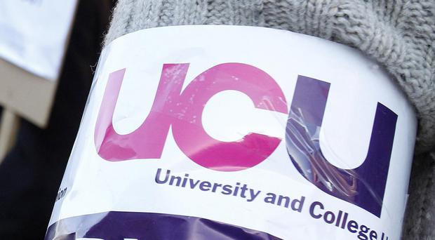 Pension cuts protest sees lecturers and staff picketing outside Bangor University