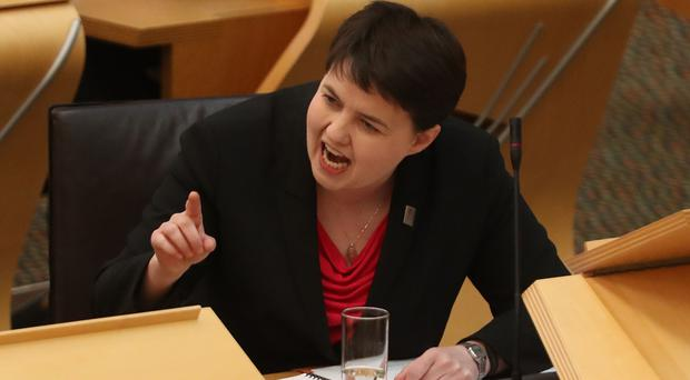 Ruth Davidson pressed Nicola Sturgeon on the case of Robbie McIntosh during First Minister's Questions (Jane Barlow/PA)