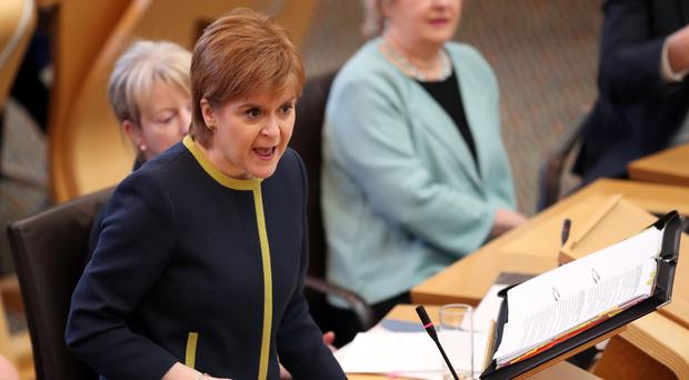 Nicola Sturgeon during First Minister's Questions (Jane Barlow/PA)