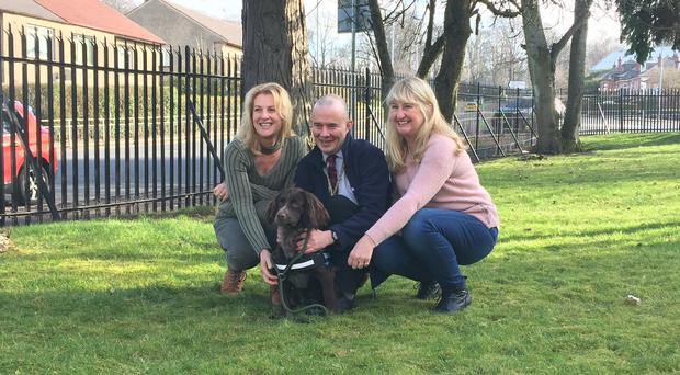 Robert Bozdech's daughters Nina Buckley and Magdalena Luscomb met veteran Tommy Masters and his new dog Antis in Glasgow (Paul Ward/PA)