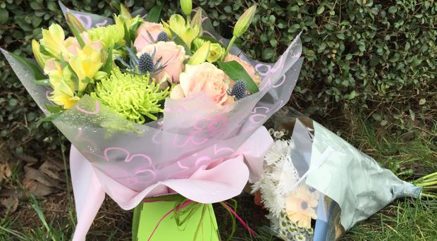Floral tributes left near the scene where a six-year-old girl was found dead at a property on Lincoln Road in Tuxford, Nottinghamshire (Josh Payne/PA)
