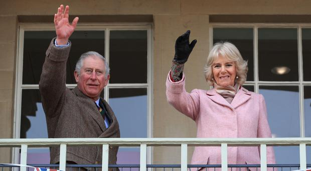 The Prince of Wales and Duchess of Cornwall, pictured during a recent visit to Piece Hall in Blackledge, Halifax, presented the Queen's Anniversary Prizes for Higher and Further Education. (Peter Byrne/PA)