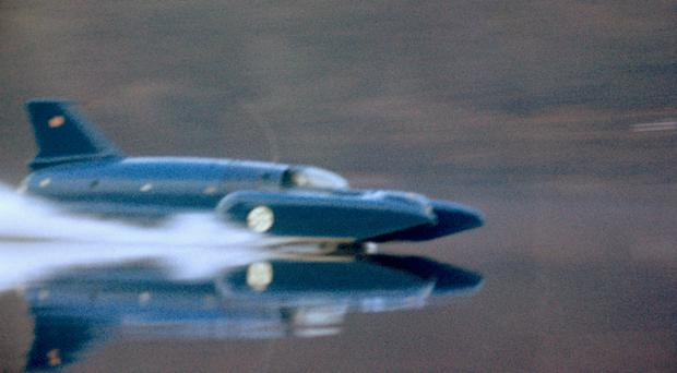 Donald Campbell's Bluebird hydroplane at speed on Coniston Water (PA)