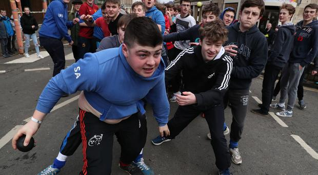 Boys tussle for the leather ball during the annual Fastern Eve Handba event on Jedburgh's High Street in the Scottish Borders (Andrew Milligan/PA)