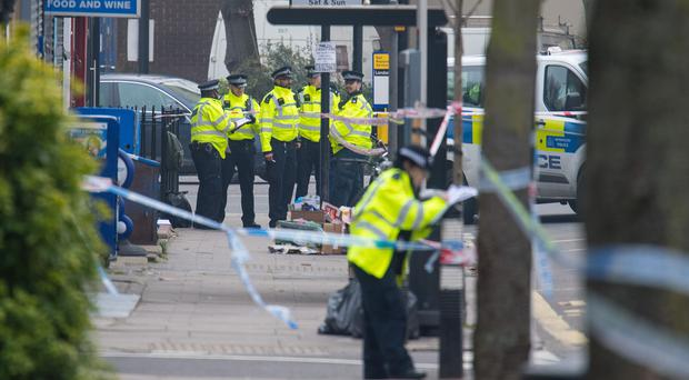 Police at the scene in Malden Road, Camden, after a young man was fatally stabbed (Dominic Lipinski/PA)