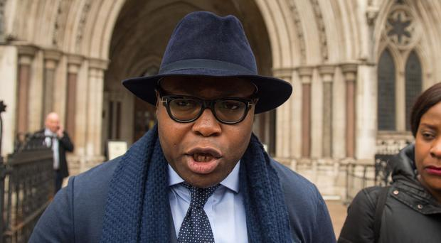 Isaiah Haastrup's father Lanre Haastrup and mother Takesha Thomas speak to the media outside the Royal Courts of Justice, London, after losing the latest round of a life-support battle over their disabled son Isaiah