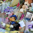 Flowers close to the scene where brothers Corey Platt-May and Casper, aged six and two, were killed (Joe Giddens/PA)