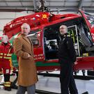 The Prince of Wales is shown an air ambulance during a visit to the South Wales airbase of the Wales Air Ambulance charity in Dafen (Aaron Chown/PA)