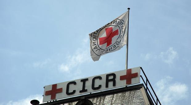 A Flag flies above the headquarters of the International Red Cross in Geneva (Empics)