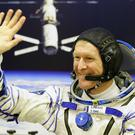 British astronaut Tim Peake waving at the Baikonur Cosmodrome in Kazakhstan. (Gareth Fuller/PA)