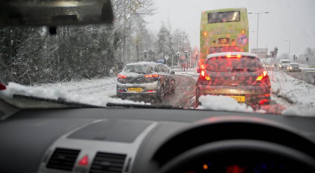 Keeping a clear windscreen is key to driving in snow, experts say (Mark Marlow/PA)
