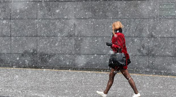 Commuters walking in the snow near London Bridge (Steve Parsons/PA)
