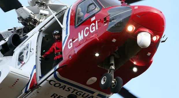 A coastguard search and rescue helicopter has been searching the area (Andrew Milligan/PA)