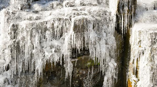 Icicles formed on a frozen waterfall near Pen y Fan mountain on Brecon Beacon National Park, Wales, as some parts of the UK are set to feel colder than the Arctic Circle as freezing temperatures continue into the week ahead (Ben Birchall/PA)