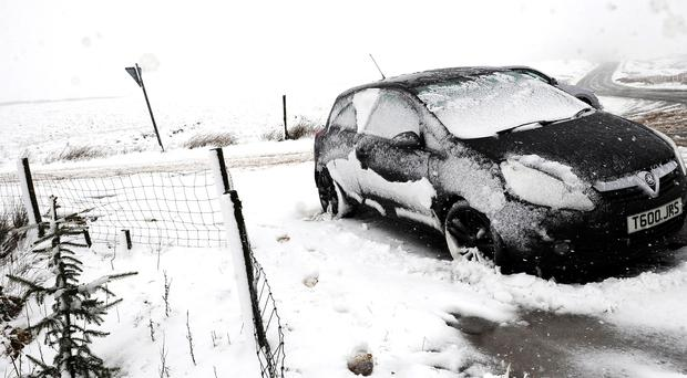 Snow is expected to affect large areas of the country (John Giles/PA)