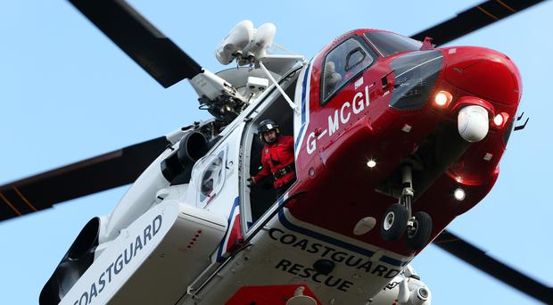 A coastguard search and rescue helicopter are combing the area on Tuesday (Andrew Milligan/PA)