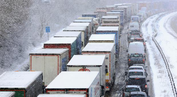 Stationary traffic on the M20 near Ashford, Kent, following heavy overnight snowfall which has caused disruption across Britain (Gareth Fuller/PA)