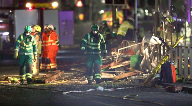 Emergency personnel at the scene of the blast on Hinckley Road (Aaron Chown/PA)