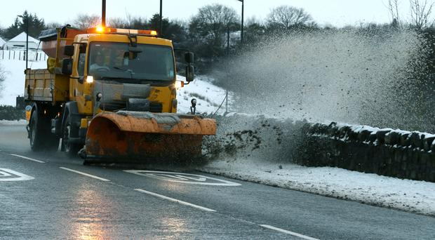 Gritters and snow ploughs are tackling the icy blast (Andrew Milligan/PA)