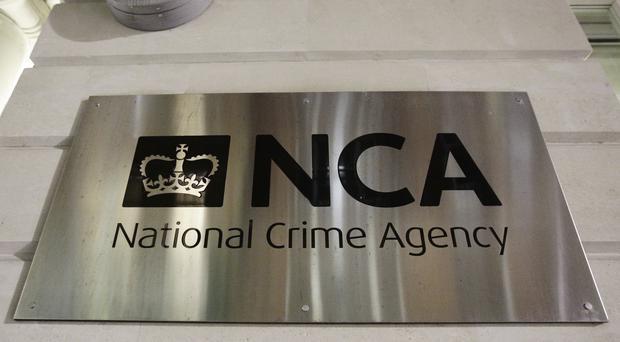 A sign outside the offices of the National Crime Agency (NCA) in London (Yui Mok/PA)